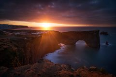 Dyrholaey red dawn. Beautiful sunrise over Dyrholaey cliffs and rocky arch, Iceland royalty free stock photography