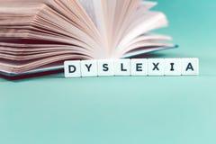 Dysleksji słowo z otwartą książką obraz stock