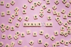 Dyslexia concept - alphabet letters on pink background Royalty Free Stock Photography