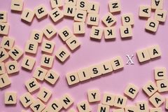 Dyslexia concept - alphabet letters on pink background Royalty Free Stock Photos