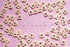 Dyslexia concept - alphabet letters on pink background Stock Photo