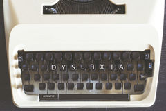 Dyslexia concept. Dyslexia word written on vintage typewriter keys. Reading difficulties concept Royalty Free Stock Photography
