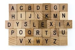 Dyslexia difficulty education alphabet. Alphabet learning dyslexia reading special education difficulty disorder words blocks letters scrabble abc school Stock Images