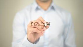 Dyslexia  , man writing on transparent screen. High quality Royalty Free Stock Photos