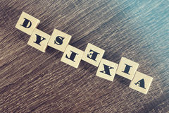 Dyslexia. Reading difficulties concept. Dyslexia word formed with wooden blocks. Reading difficulties concept Royalty Free Stock Image