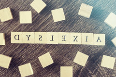 Dyslexia. Reading difficulties concept. Dyslexia word formed with wooden blocks. Reading difficulties concept Stock Photography