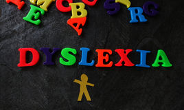 Dyslexic child play letters Royalty Free Stock Images