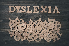 Dyslexie de Word sur un fond en bois Image libre de droits