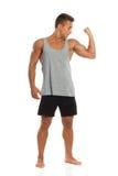 Dysponowany mężczyzna Napina bicepsy Obraz Royalty Free
