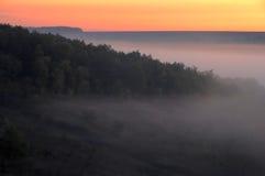 dystansowy mgławy wzgórzy wschód słońca widok Zdjęcie Stock