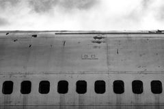 Cabin windows on an old abandoned jet plane / aircraft stock image