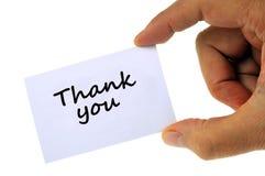Dziękuje ciebie pisać na białej karcie zamkniętej w górę royalty ilustracja