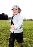 Działająca chłopiec łąka zdjęcie royalty free