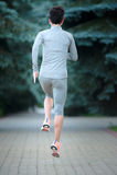 Działający stażowi biegacze jogging na drogowym outside w tylni widoku ru zdjęcie stock