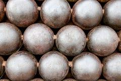 Działo piłki układać w palowym tle Obrazy Stock