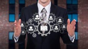 Działu zasobów ludzkich biznesu pojęcie Biznesmen naciska hr ikonę na wirtualnym ekranie Zdjęcie Stock