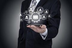 Działu zasobów ludzkich biznesu pojęcie Biznesmen naciska hr ikonę na wirtualnym ekranie Zdjęcia Stock