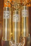 Dziadek zegaru mosiądz obciąża pulleys iluminujących Fotografia Royalty Free