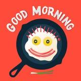 Dzień dobry - uśmiechnięta twarz robi z smażącymi jajkami Zdjęcie Royalty Free