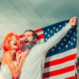 Dzień Niepodległości para z flaga Zdjęcia Royalty Free