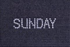 Dzień tygodnia, słowo NIEDZIELA zrobi rhinestones krystaliczny kolor o Zdjęcia Royalty Free