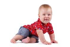 Dziecięcy dziecko siedzi szczęśliwy ono uśmiecha się pojedynczy białe tło Obraz Stock