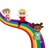 Dzieci ślizgają się puszek na tęczy Zdjęcie Stock