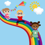 Dzieci ślizgają się puszek na tęczy Fotografia Royalty Free
