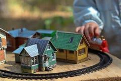 Dzieci bawią się z miniaturą stary miasteczko Obraz Royalty Free