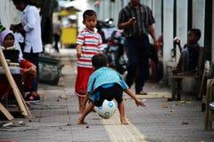 Dzieci bawić się w Południowym Yogyakarta Fotografia Royalty Free