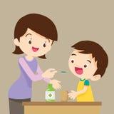 Dzieci jedzą medycynę Fotografia Royalty Free
