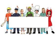 Dzieci Jest ubranym Przyszłościowych praca mundury fotografia stock