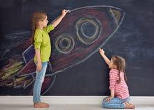 Dzieci rysują rakietę Obrazy Stock