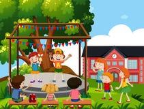 Dzieci wykonują kukiełkowego przedstawienie przy szkołą ilustracji