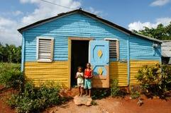 Dzieci z zabawkami przed one do domu Obrazy Royalty Free