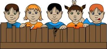 Dzieci za ogrodzeniem zdjęcia stock