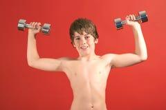 dzieciak żelaza pompuje young fotografia stock