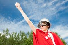 Dzieciak bawić się bohatera Fotografia Royalty Free