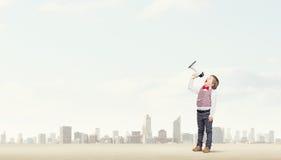 Dzieciak chłopiec z megafonem obraz stock