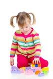 Dzieciak dziewczyna bawić się zabawki obraz stock