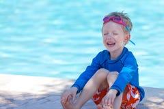 Dzieciak pływackim basenem Obrazy Stock