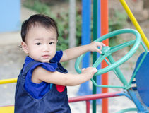 Dzieciak przejażdżka zabawkarski samochód Obrazy Royalty Free