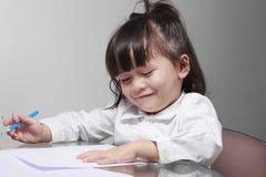 Dzieciak uczy się rysować Obrazy Stock