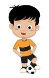 Dzieciak z jego piłką Zdjęcie Royalty Free