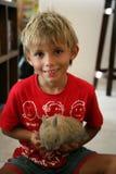 Dzieciak z królikiem Obrazy Royalty Free