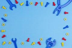 Dzieciak zabawek Odgórny widok Kolorowi zabawek narzędzia na Błękitnym tle Obraz Stock