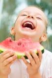 Dzieciaka łasowania arbuz Fotografia Stock