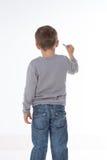 Dzieciaka główkowanie z kredą w ręce Zdjęcie Royalty Free