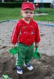 dzieciaka małe bawić się piaska zabawki Obrazy Stock