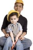 Dzieciaka ojca pracownik budowlany Zdjęcia Royalty Free